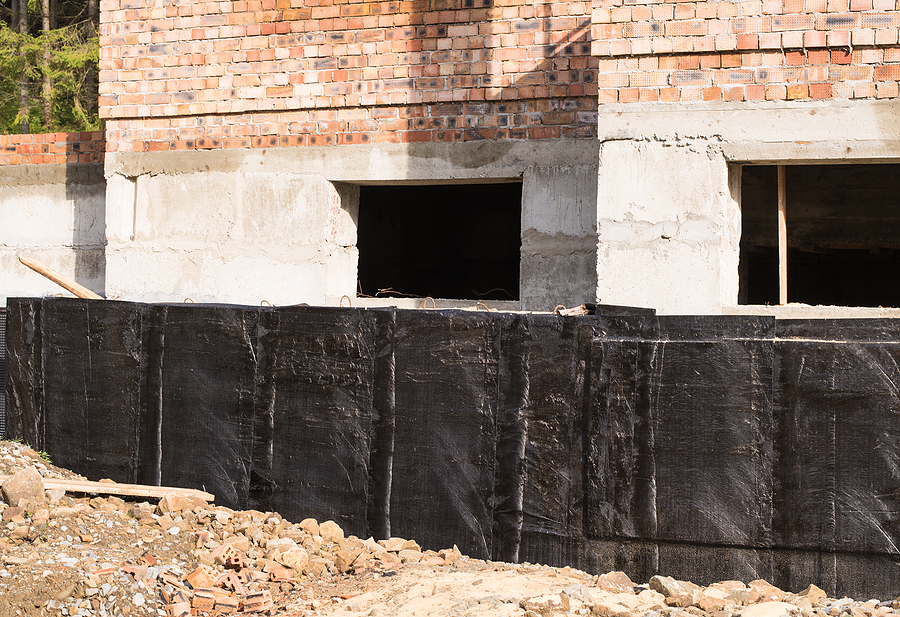 construction techniques for waterproofing basement and foundations. Insulation material on the basement concrete wall. House energy saving.