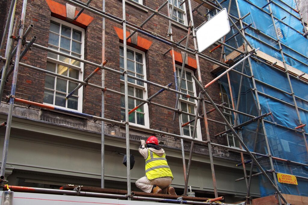 a construction worker on the metal scaffolding