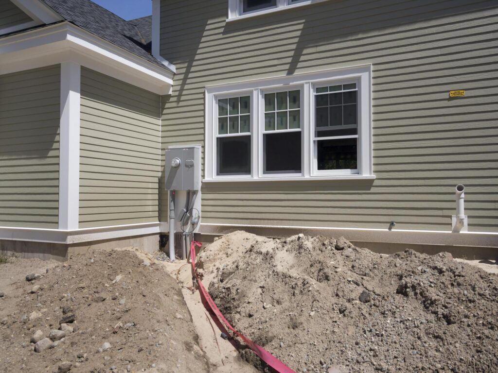 front house with excavation/ sand